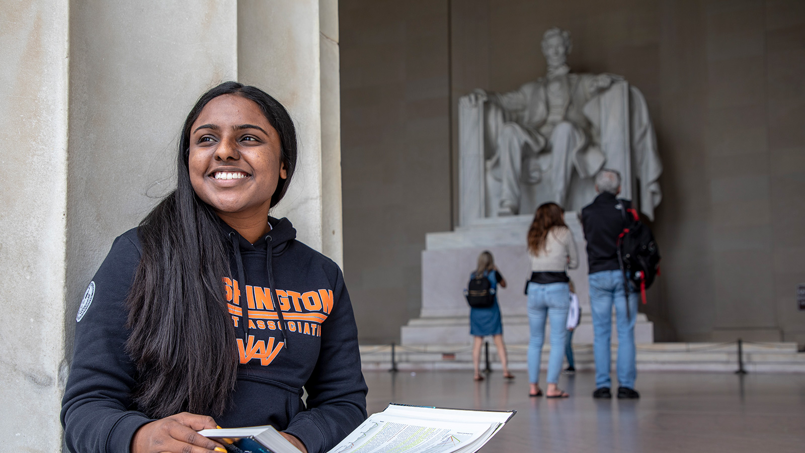 Smiling student in front of Lincoln Memorial