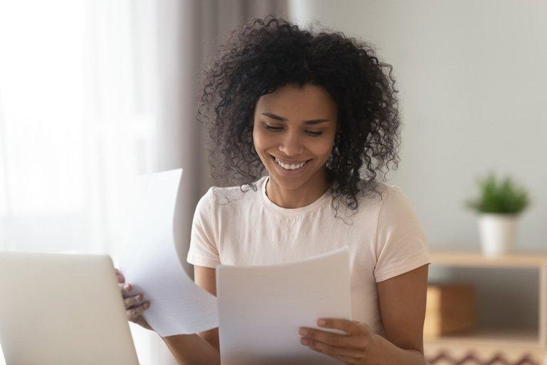 WAU Student Looking Over Graduate Loan Paperwork