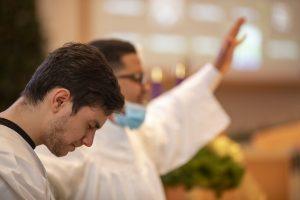 Rodrigo Lima praying in preparation for baptism.